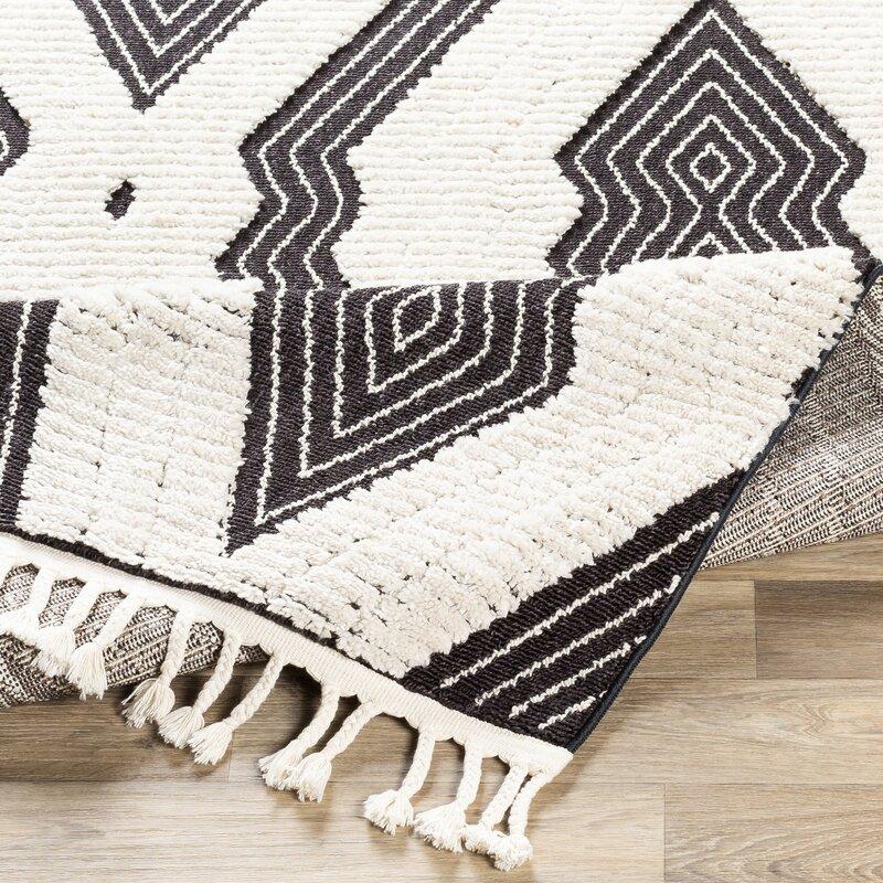 Macalla Global-Inspired Black/Ivory Area Rug