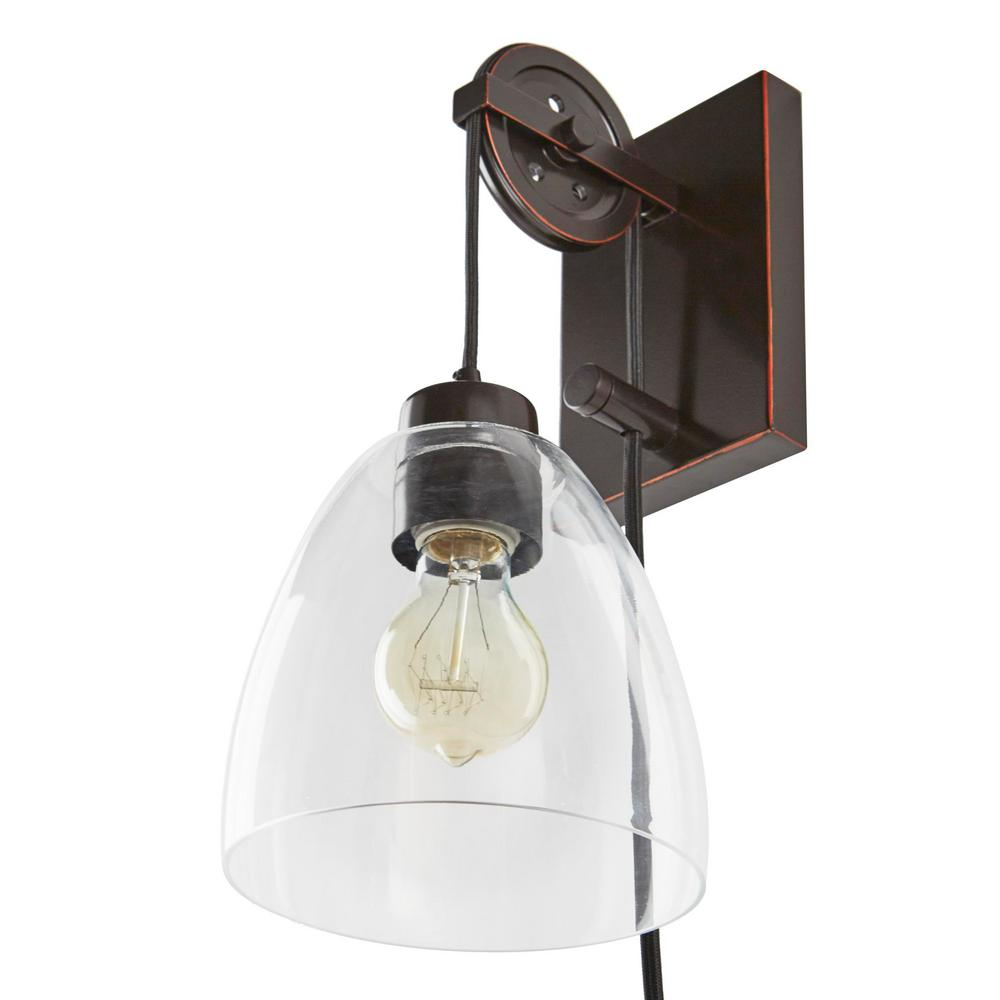 Home Decorators Collection Industrial Pulley 1-Light Clear Glass Plug-in Wall Sconce with Bulb