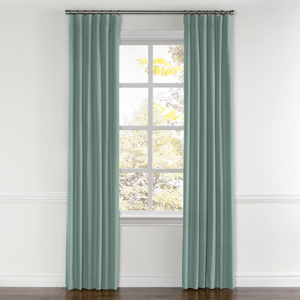 gray and white grommet curtains