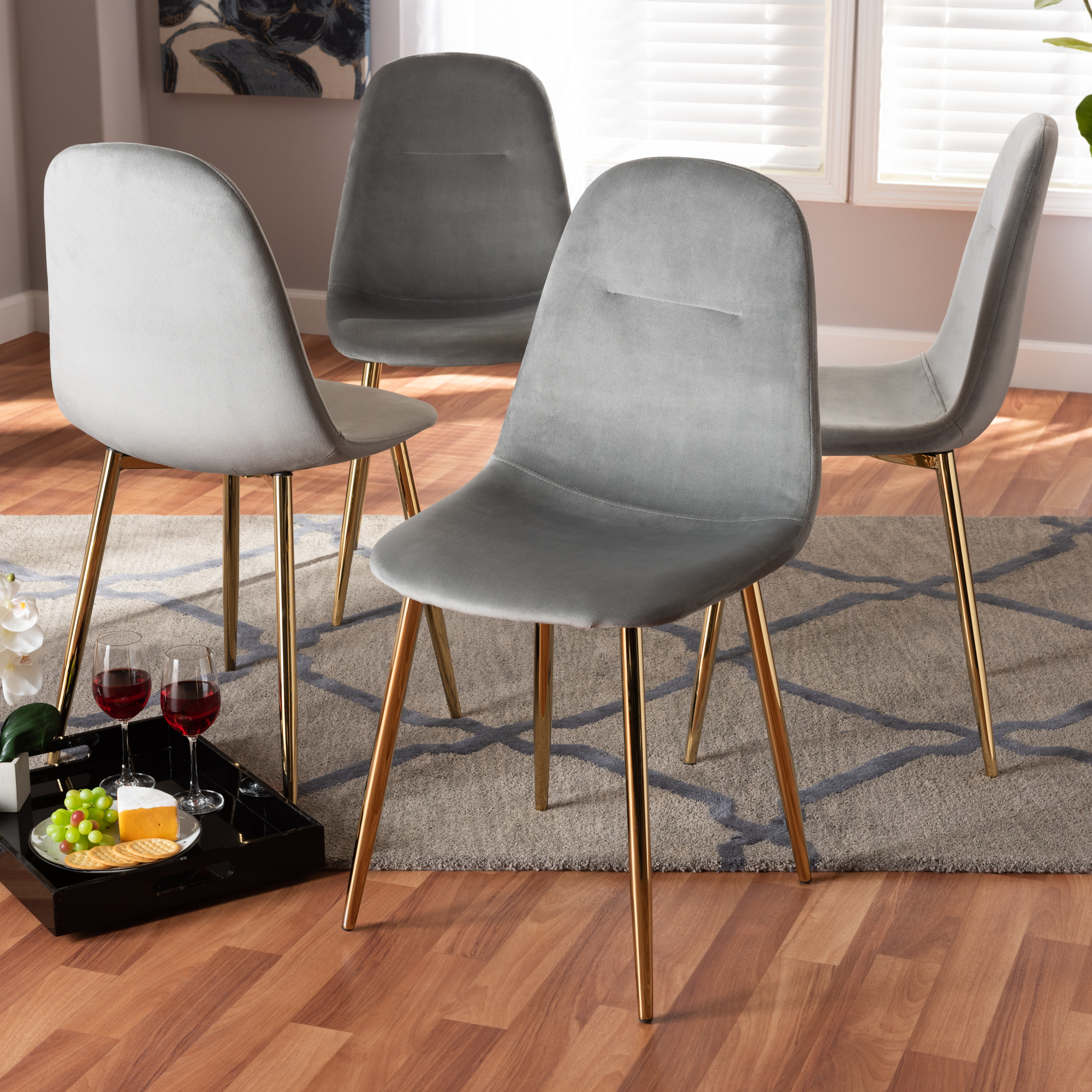 Baxton Studio Elyse Glam and Luxe Grey Velvet Fabric Upholstered Gold Finished 4-Piece Metal Dining Chair Set